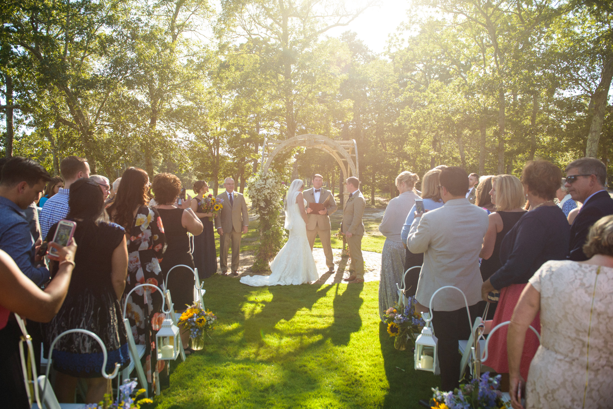 Wedding ceremony on the grounds of Farm Neck Golf Club  photo by David Welch Photography