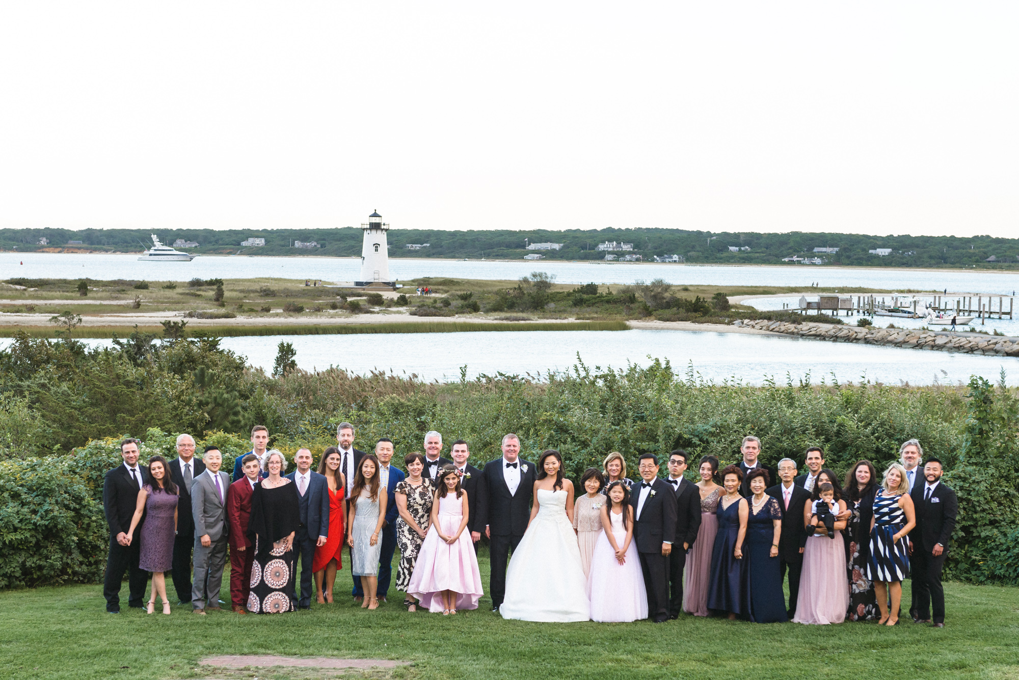 A group photo of a wedding party across the street from the Harbor View Hotel in Edgartown  photo by David Welch Photography