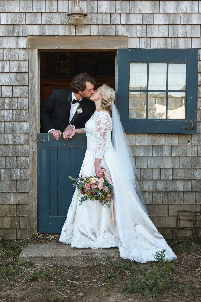 A bride and groom at a Island Alpaca Company wedding on Martha's Vineyard photo by David Welch Photography