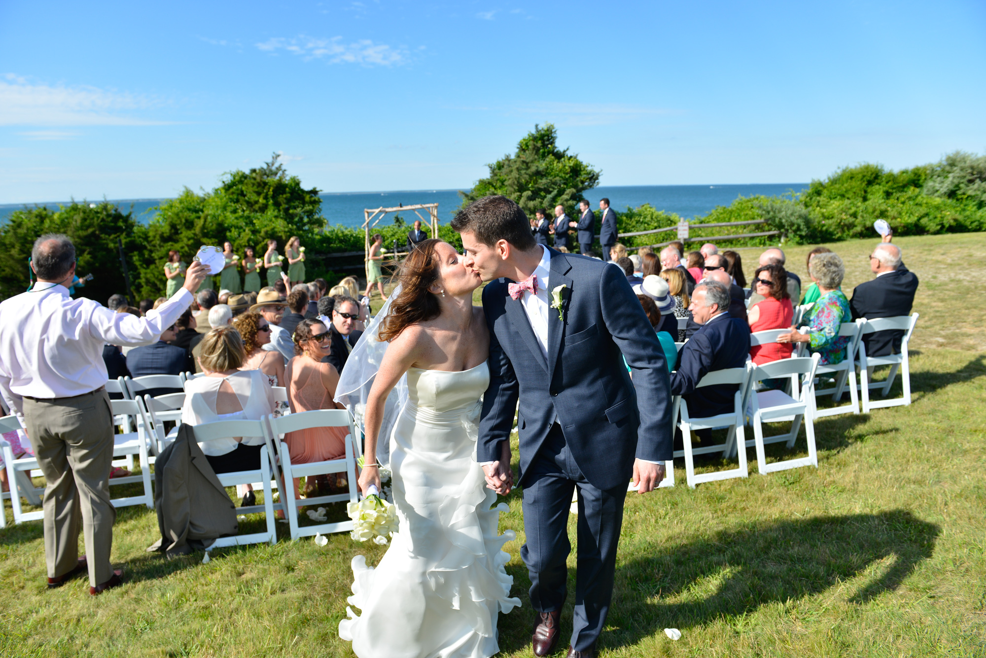 A bride and groom exit their wedding ceremony at the East Chop Lighthouse in Oak Bluffs photo by David Welch Photography