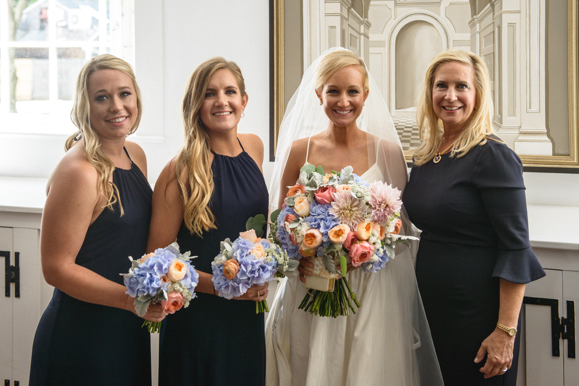A bride and her bridesmaids inside the Old Whaling Church in Edgartown  photo by David Welch Photography