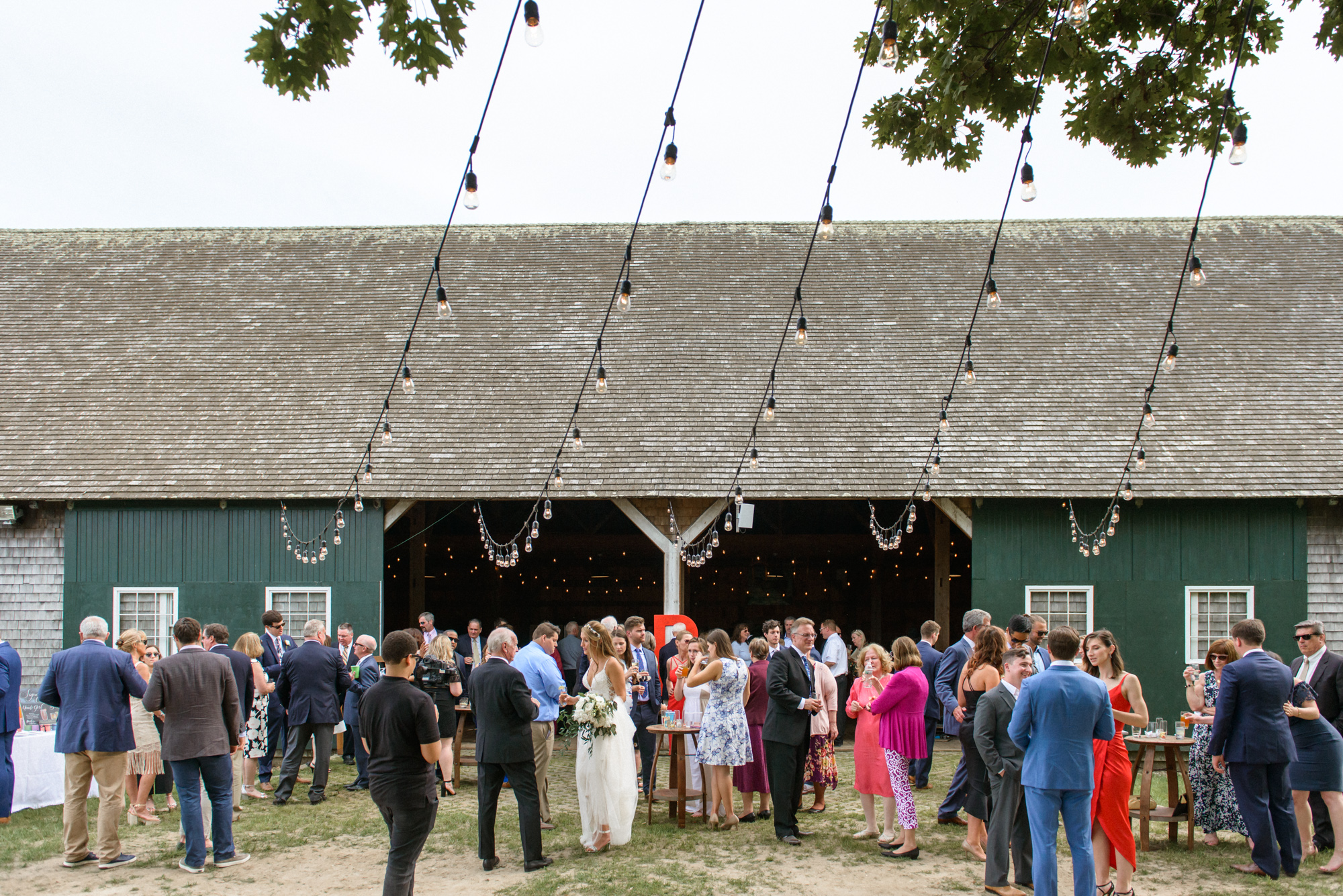 A wedding cocktail hour at the Martha's Vineyard Agricultural Hall in West Tisbury photo by David Welch Photography