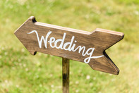 Sign pointing to a wedding reception photo by David Welch Photography
