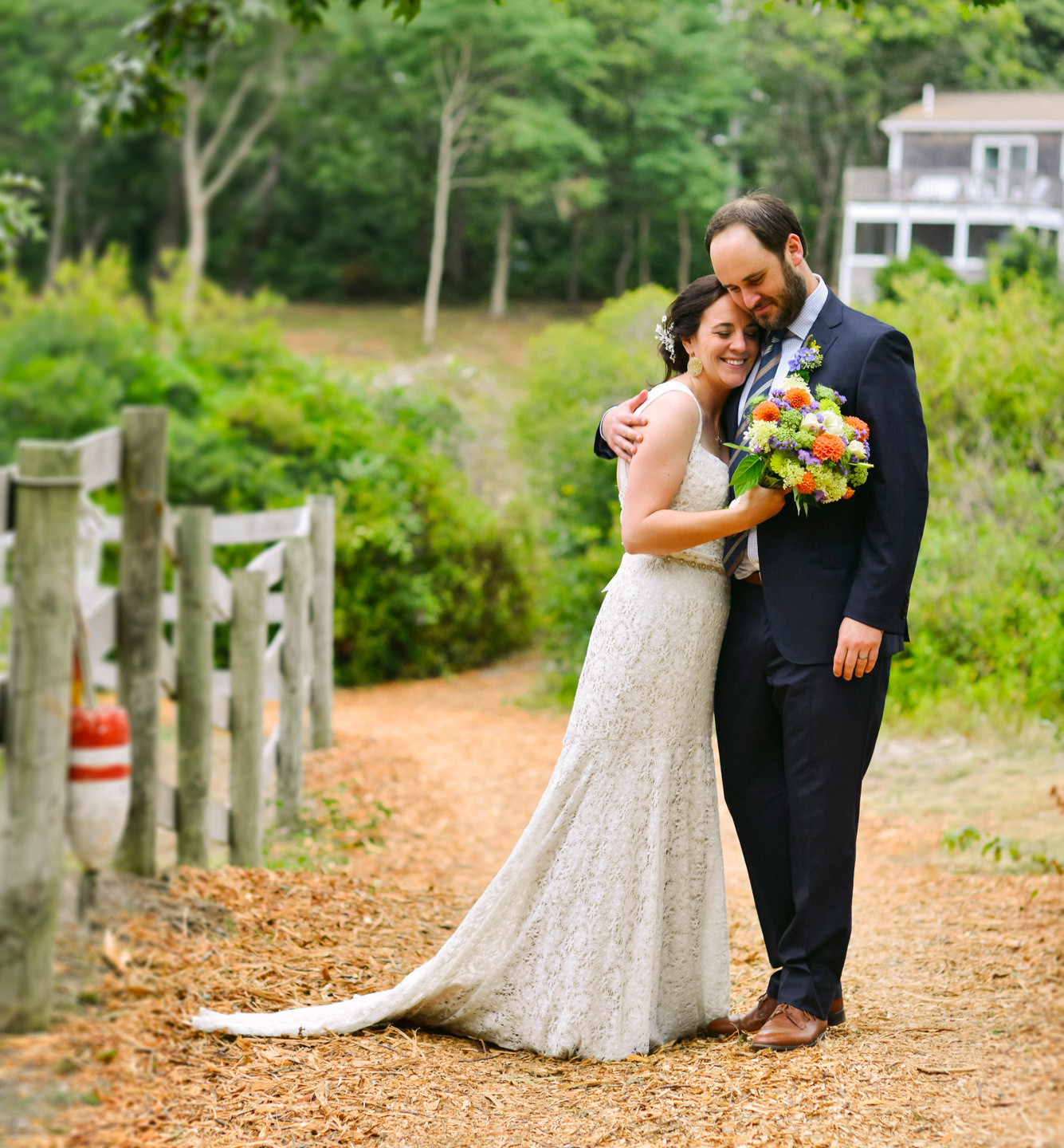 A bride and groom on a path at The Beach Plum Inn & Restaurant photo by David Welch Photography