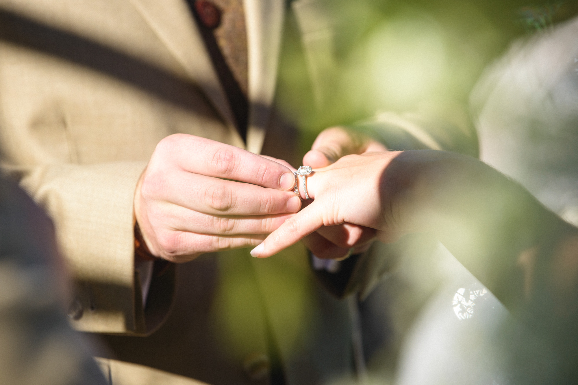 Wedding ceremony ring exchange at Farm Neck Golf Club  photo by David Welch Photography