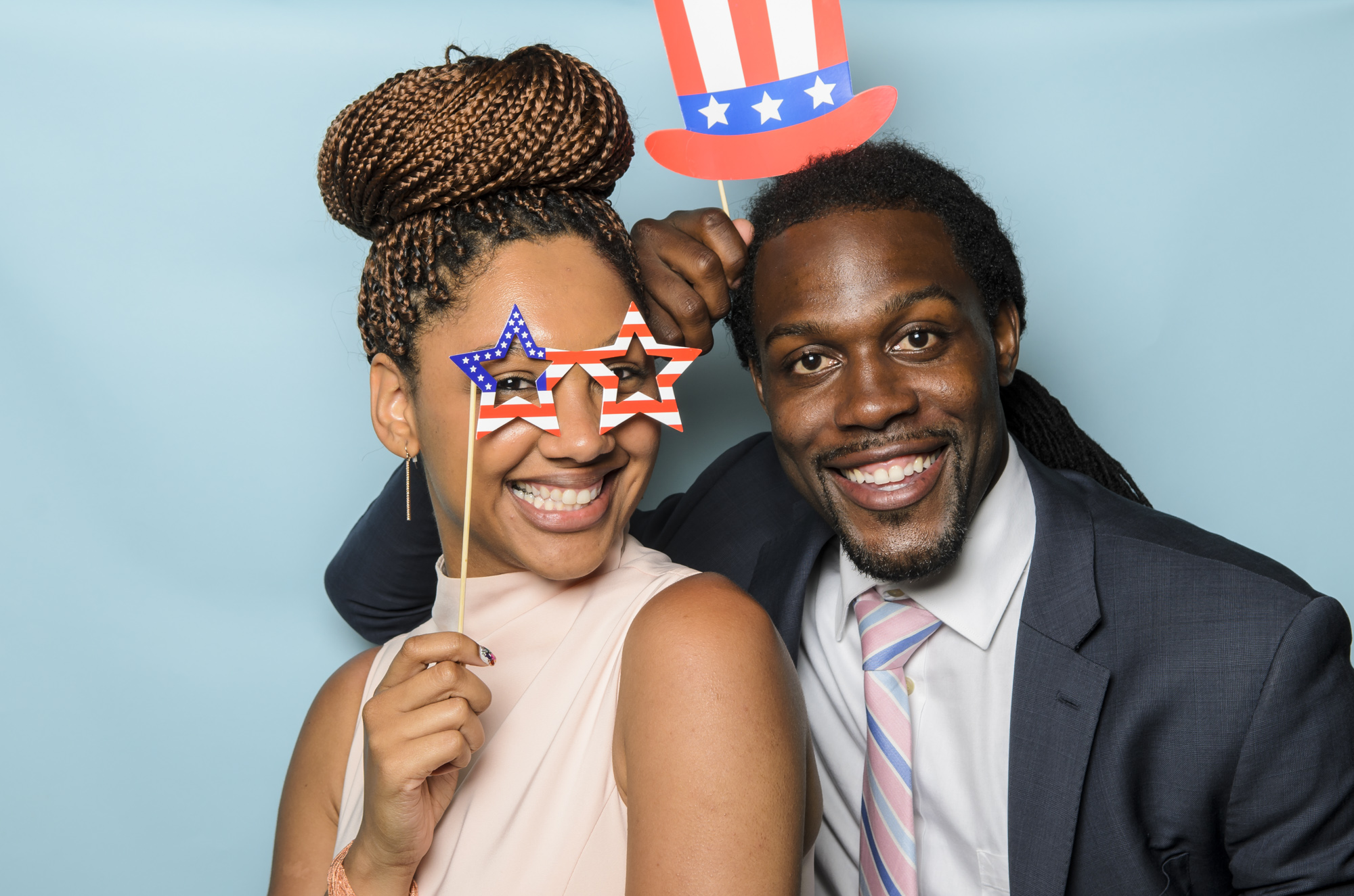 People in a photo booth photo by David Welch Photography
