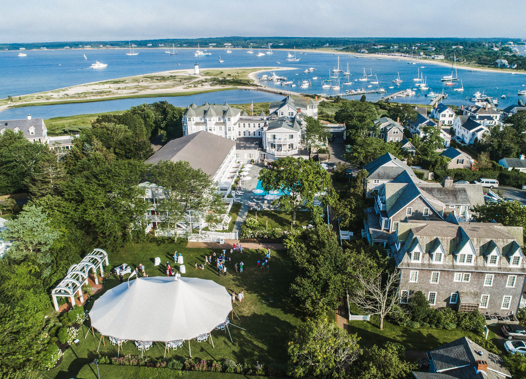 Drone photo of the Harbor View Hotel a martha's vineyard wedding venues grounds with a tent looking out towards the Edgartown Lighthouse  photo by David Welch Photography