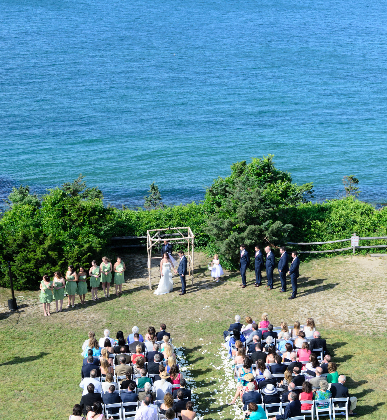 A view of a wedding ceremony from atop the East Chop Lighthouse in Oak Bluffs photo by David Welch Photography