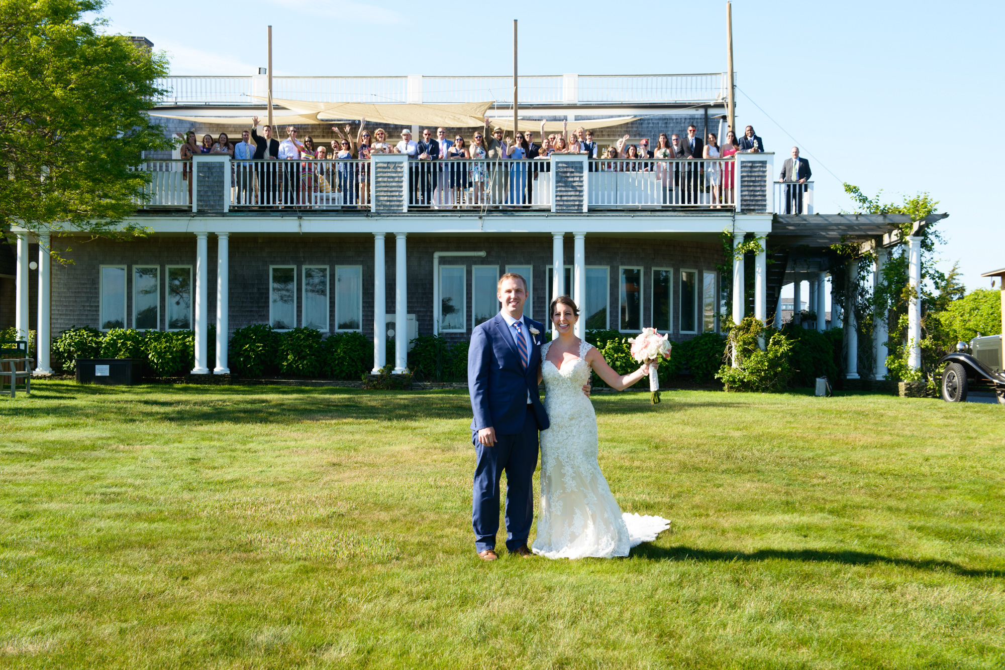 A bride and groom on the lawn of the Winnetu Oceanside Resort  photo by David Welch Photography