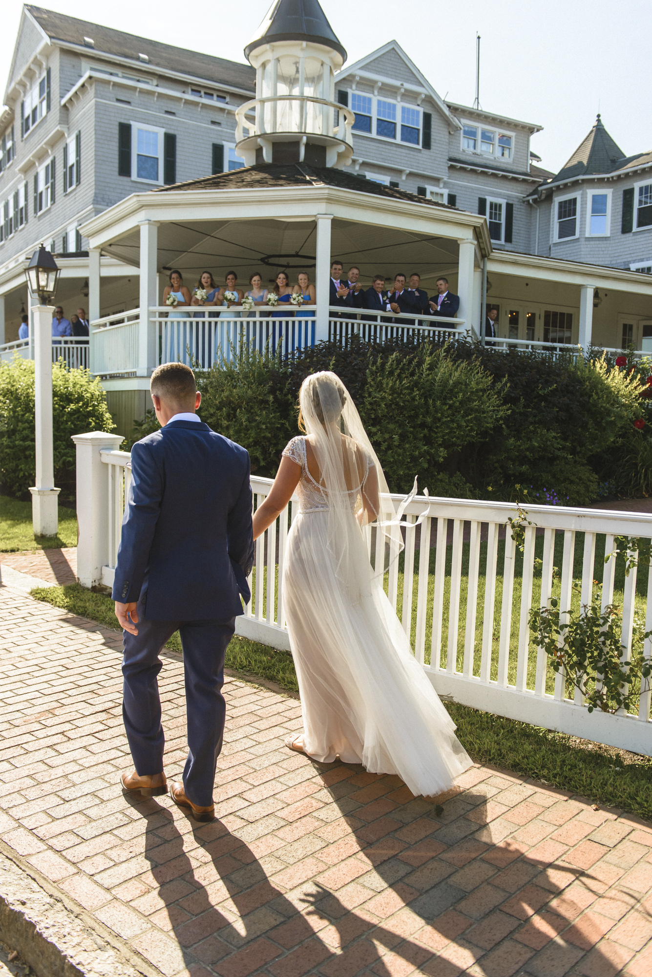 A bride and groom approach the Harbor View Hotel photo by David Welch Photography