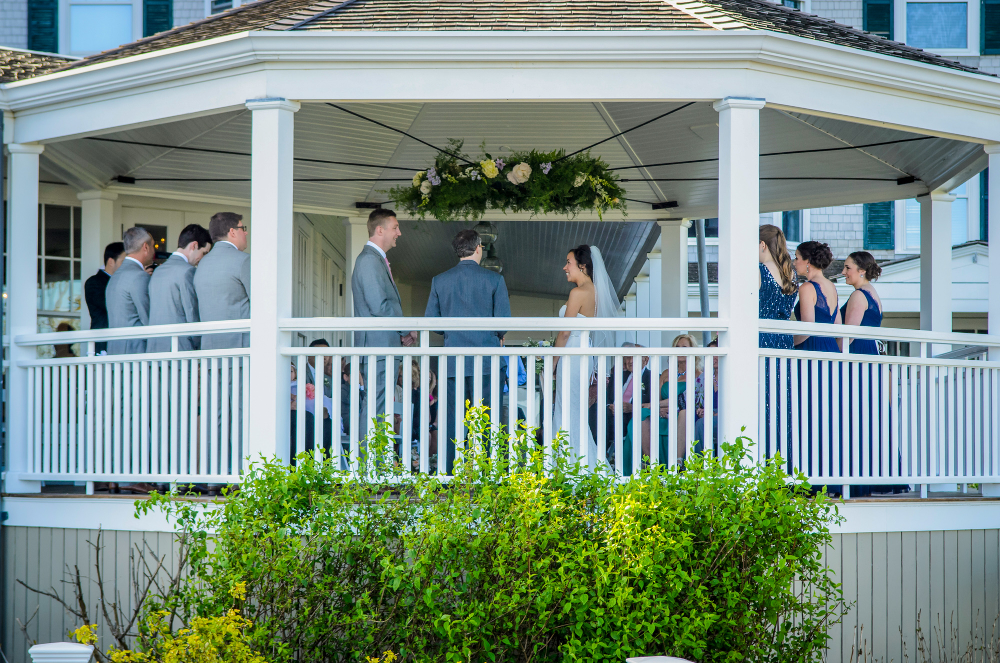 A unique vantage point of a gazebo ceremony at the Harbor View Hotel  photo by David Welch Photography