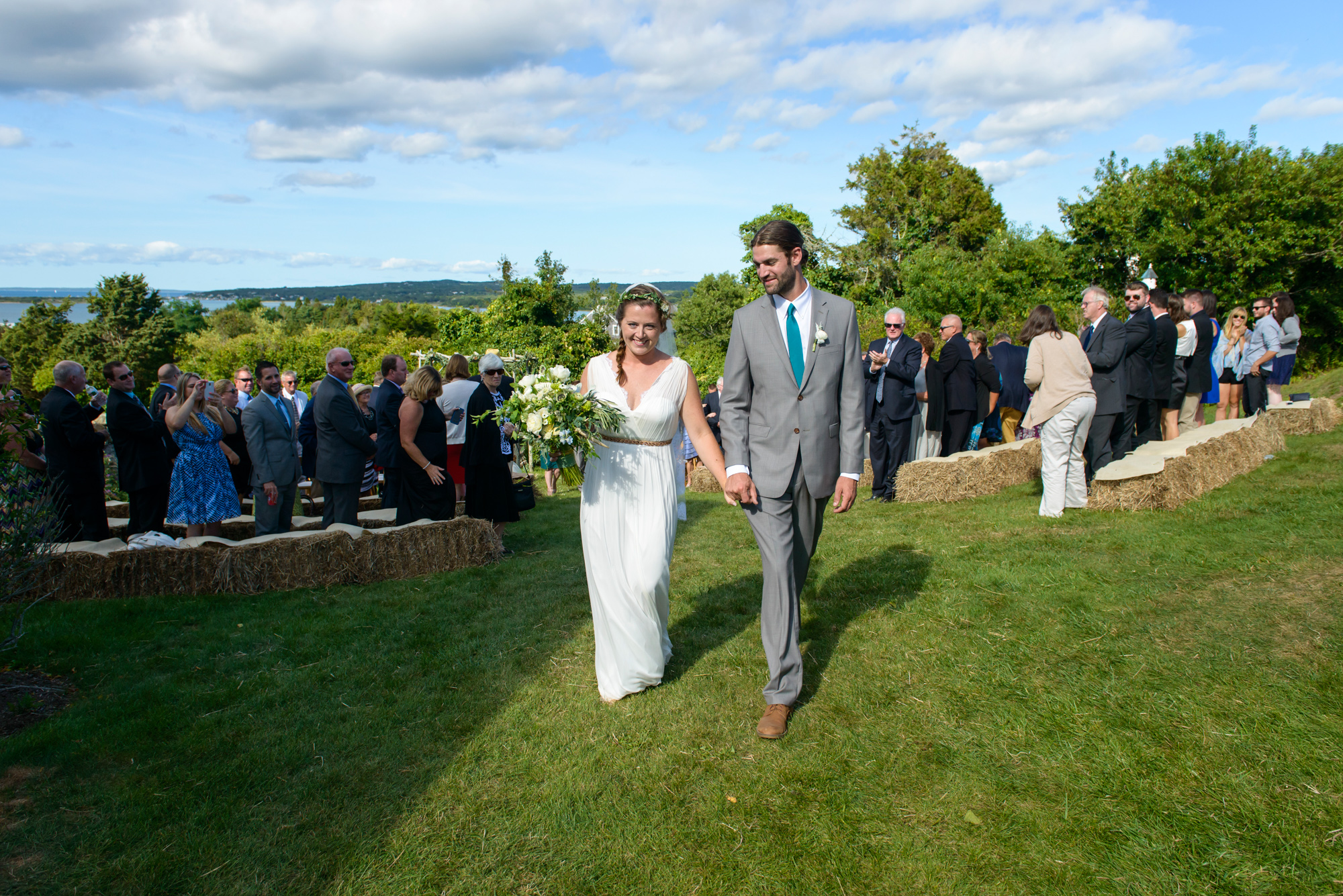 A bride and groom exit their ceremony at The Tower House in Chilmark photo by David Welch Photography