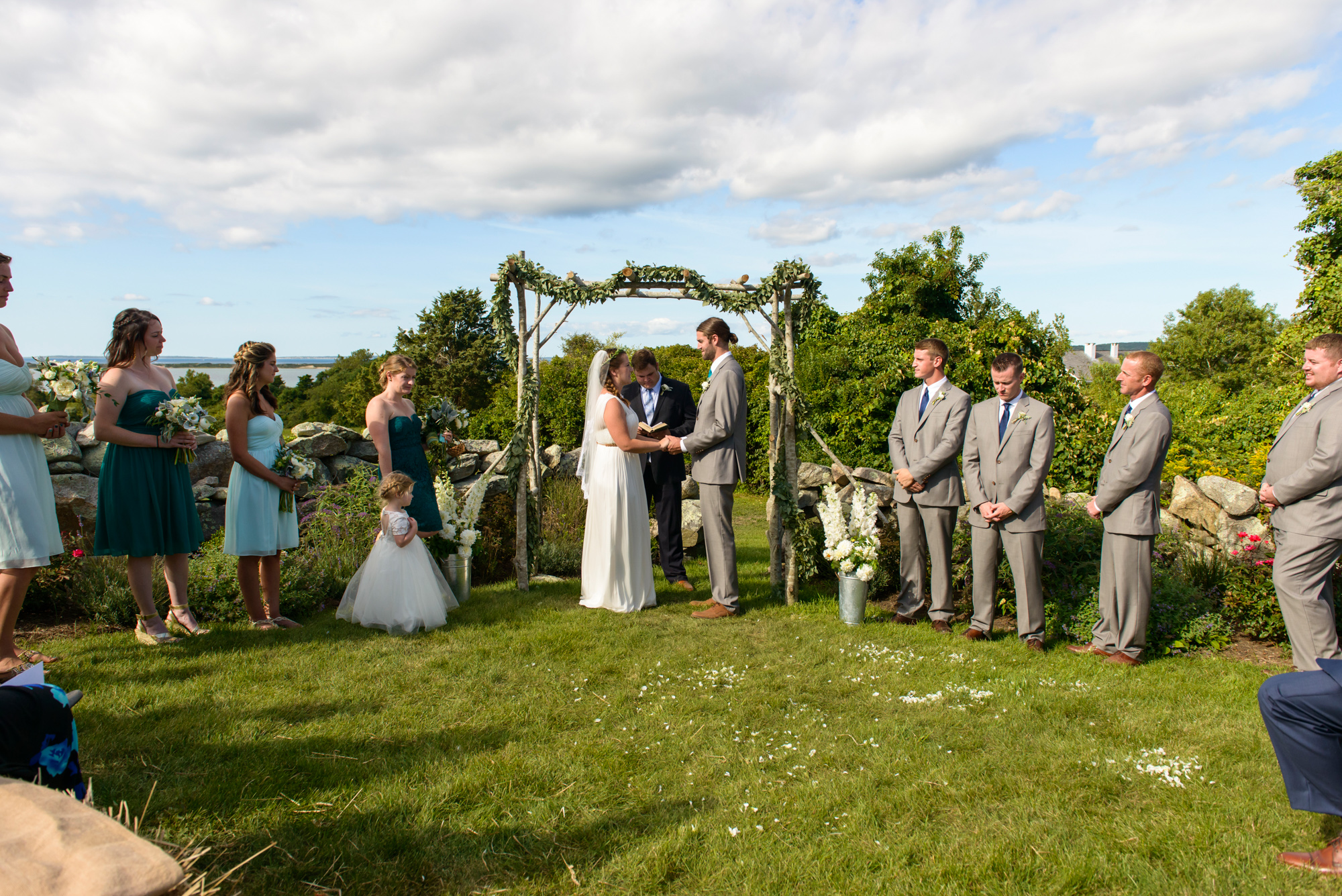 A wedding ceremony overlooking the Vineyard Sound at The Tower House in Chilmark photo by David Welch Photography