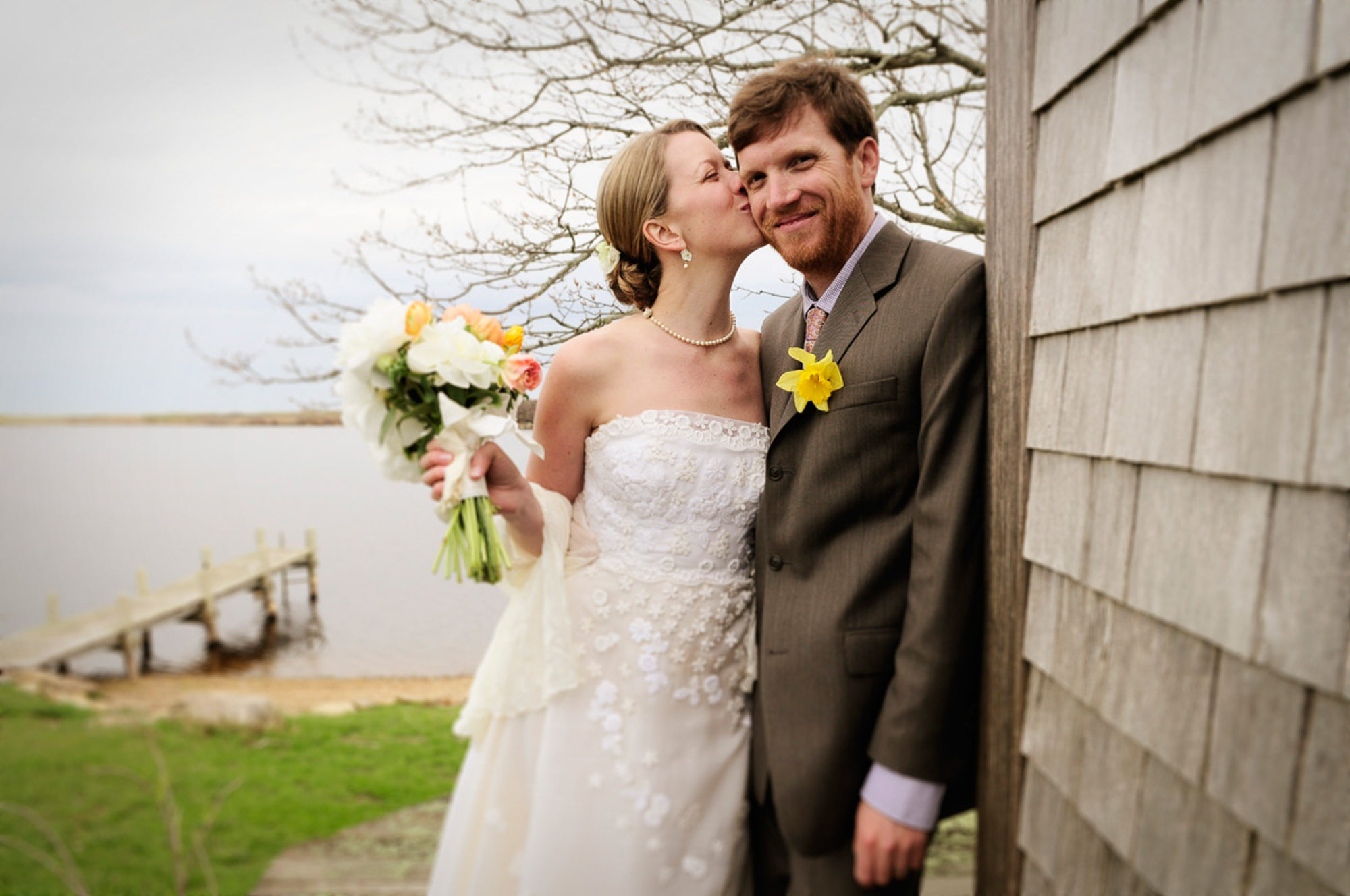 A bride and groom posing at Allen Sheep Farm in Chilmark photo by David Welch Photography