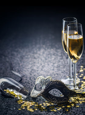 mask and champagne with star shaped conf