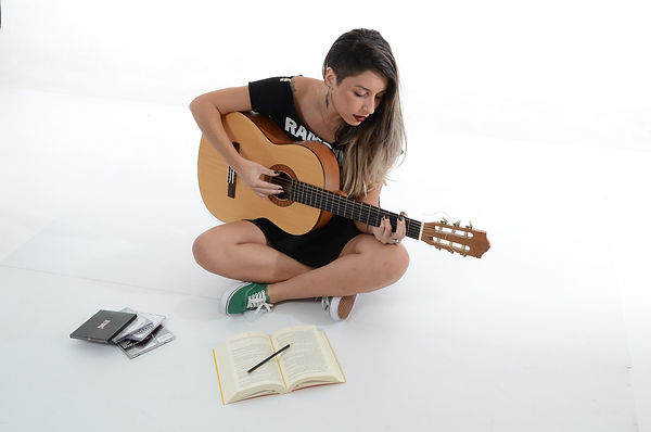 Guitar Player Practicing With Notes.jpg