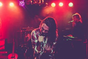 rock singer with acoustic guitar.jpg
