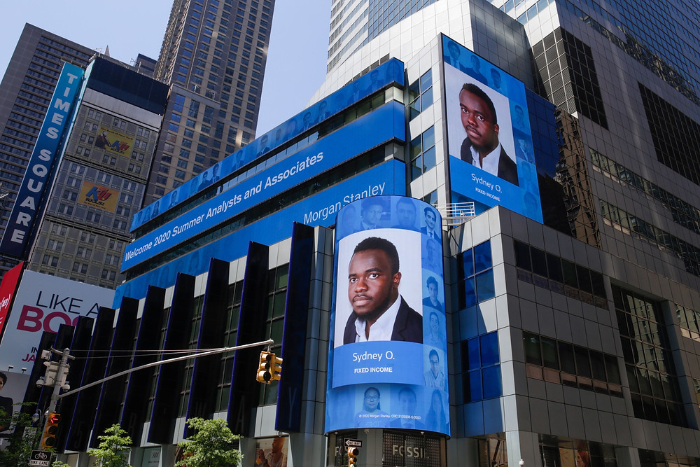 Sydney's photo on the rotating digital display at Morgan Stanley's headquarters in Times Square in New York City.