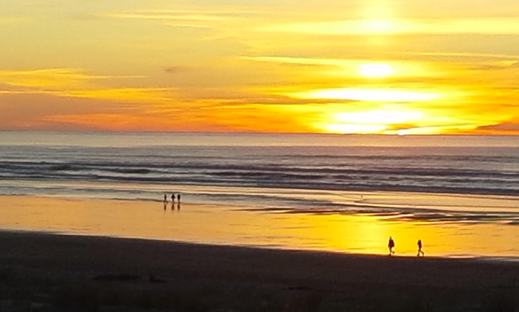 A golden Cannon Beach sunset
