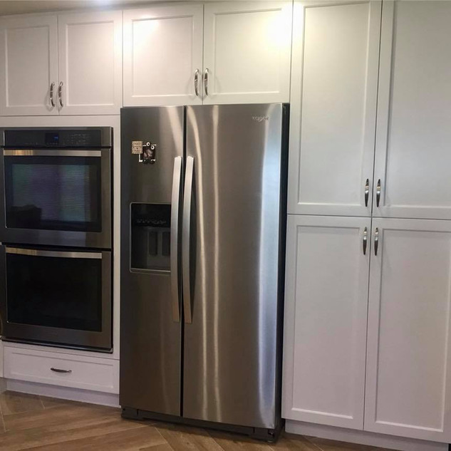 Built-in fridge enclosure and pantry