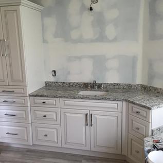 Custom vanity with linen storage
