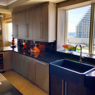 Modern flat-panel kitchen with custom farmhouse sink cabinet