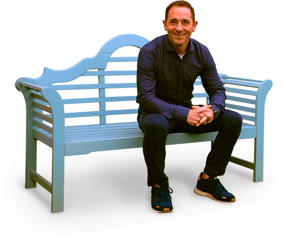Garry Lewis sitting on a bench