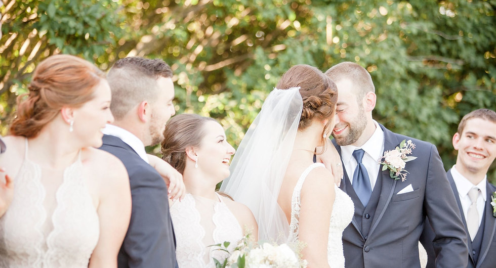 Wedding Photography of a happy, smiling bride and groom with their wedding party