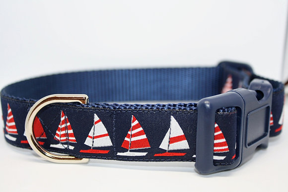 Red And White Sailboats On Navy