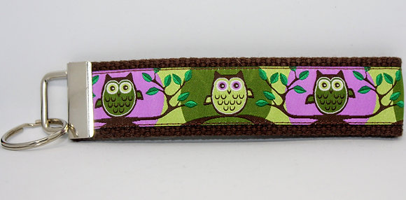 Green and Purple Owls on Brown