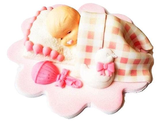 Rozā bebītis zem sedziņas