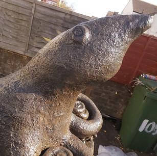 Eye see you. stone octopus sculpture. Celotex sculpt.