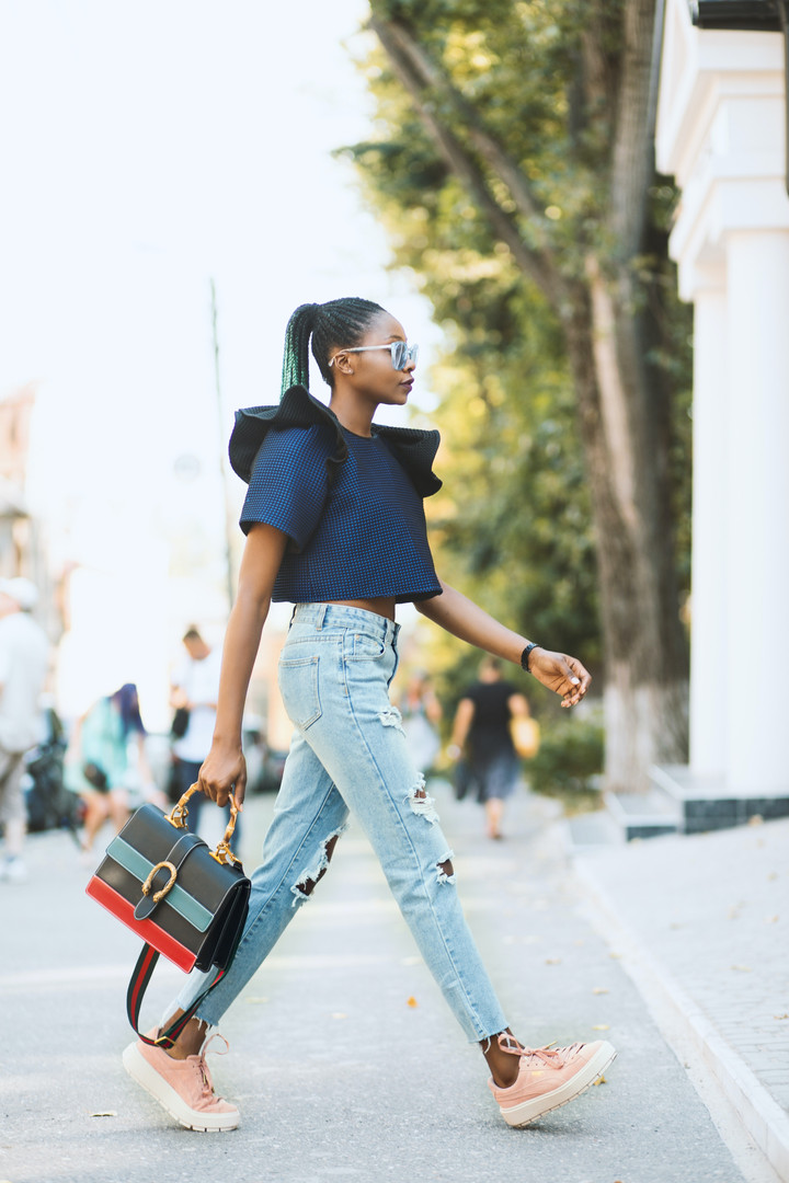 woman-in-blue-crop-top-and-distressed-bl