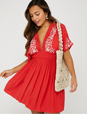 Red tunic with white flower embroidery