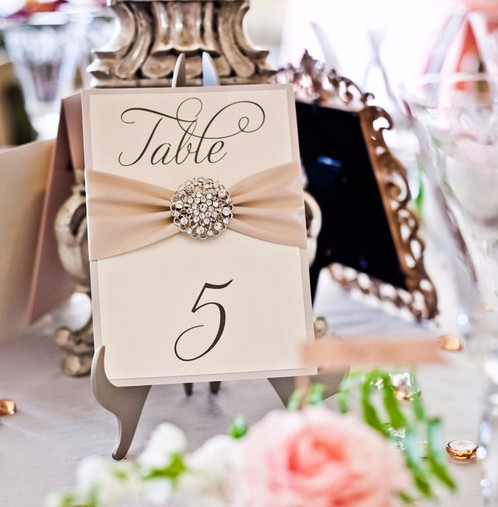 Wedding Table Number Cards Embellished With Satin Ribbon And Crystal Brooch Colors Shown Silver Shimmer Backing Ivory Printed Layer