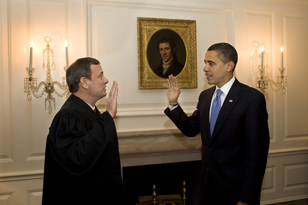 President Obama takes his oath of office from Supreme Court Justice John Roberts.