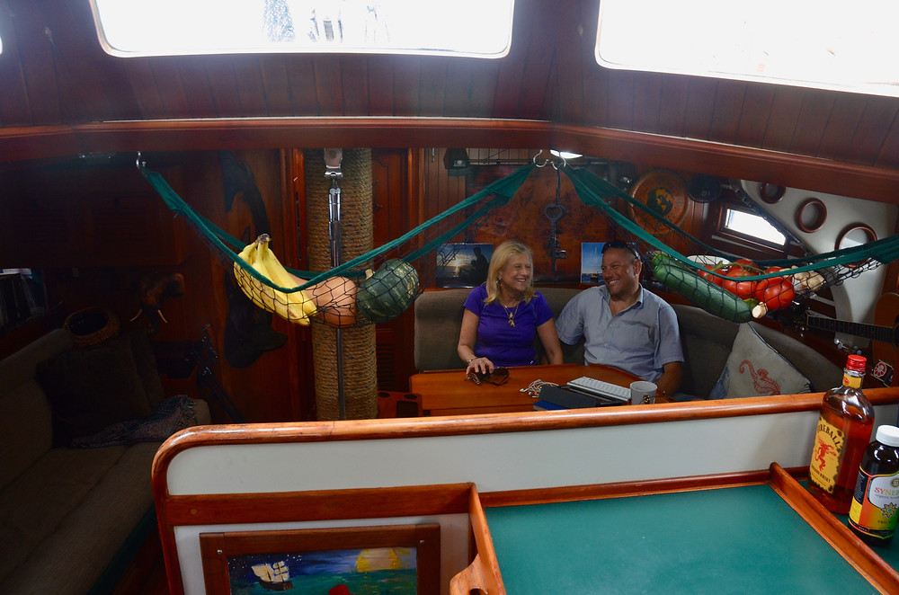 Brandon and Jackie relax amid ships on the Emerald of Pleiades
