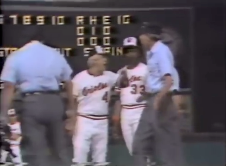 Baseball manager argues with umpire