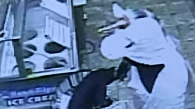 A man in a unicorn costume was captured on surveillance video robbing a High's convenience store near Baltimore. (Handout)
