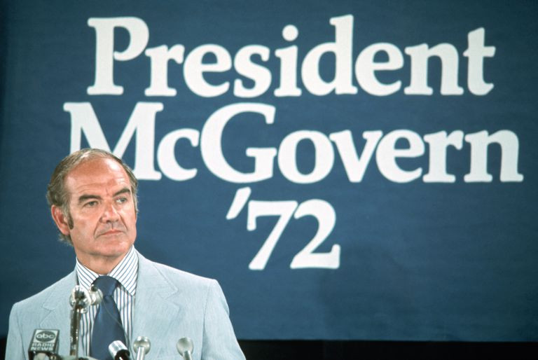 McGovern in front of campaign sign