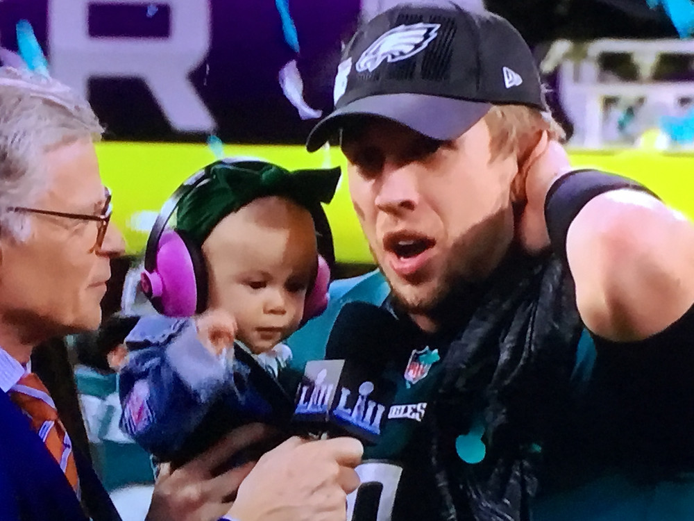 Super Bowl LII MVP Nick Foles with his baby daughter, Lily, after being named Super Bowl MVP.