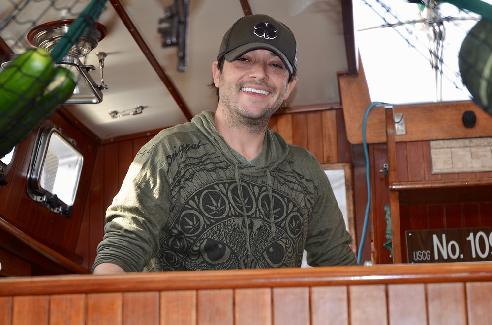 Kyle Davis, owner of the Emerald of Pleiades, shown in the galley.
