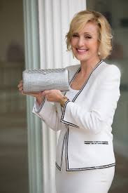 Lana Marks shows off one of her fancy handbags.