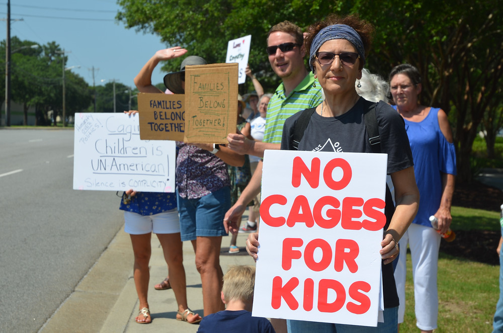 Myrtle Beach, SC residents protest Trump immigration policy that separated children from their parents.