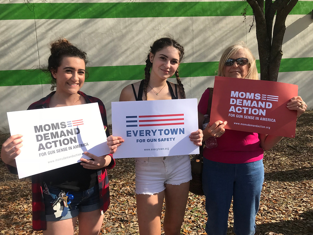 L-R are Mikaela and Karleigh Campman with Bammaw (Jackie Cristiano) at the Horry County Democratic Party's demonstration at the Myrtle Beach Gun Show.