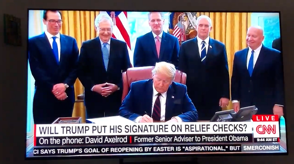 Trump signs CARES Act.
