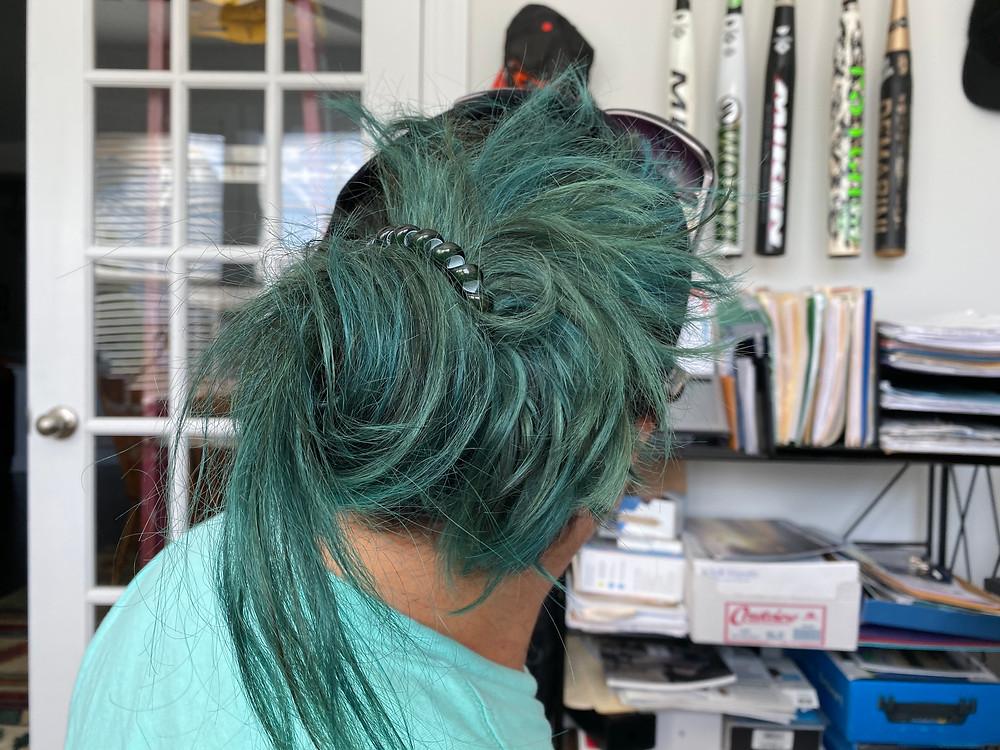 Hair died green, sort of.