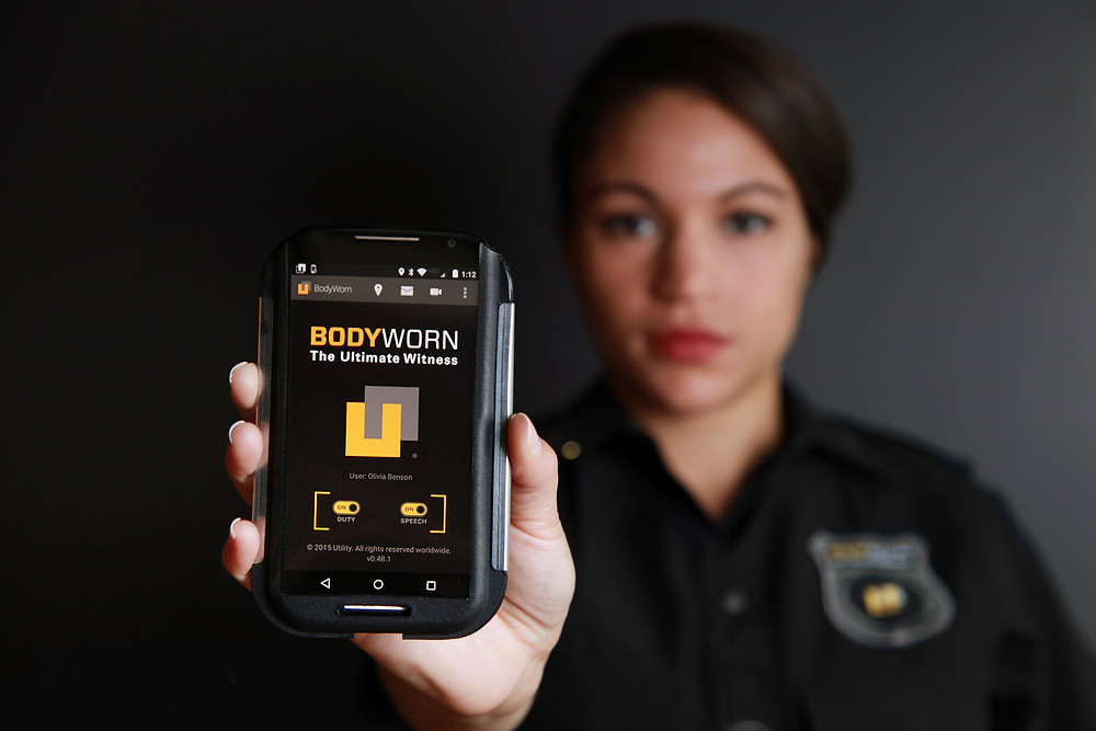 A police officer demonstrates her body camera.