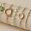 Thumbnail: Bohemian Stackable Green and Gold Bracelets