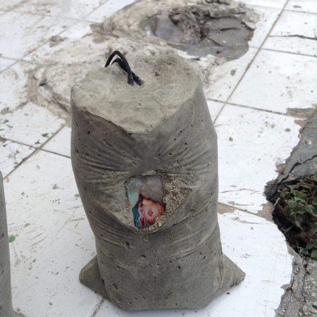 Rebuild, 2015, cement, concrete blocks, rice, plastic bags, plastic toys, tiles